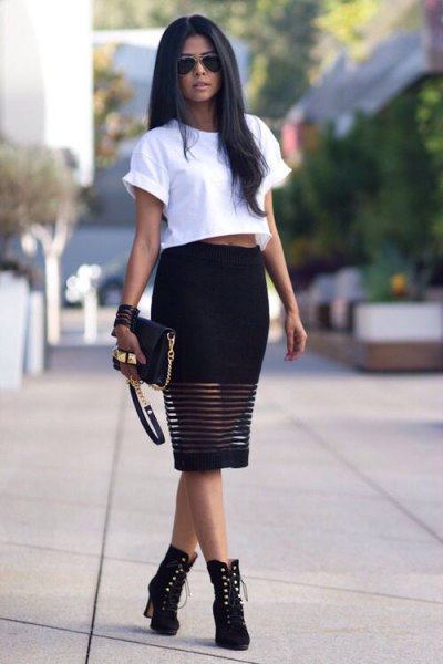 white short t-shirt with black midi dress and boots