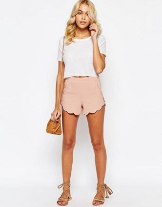 white short t-shirt with light pink shorts with scalloped hem