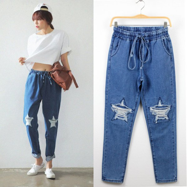 white short t-shirt with ripped baggy jeans