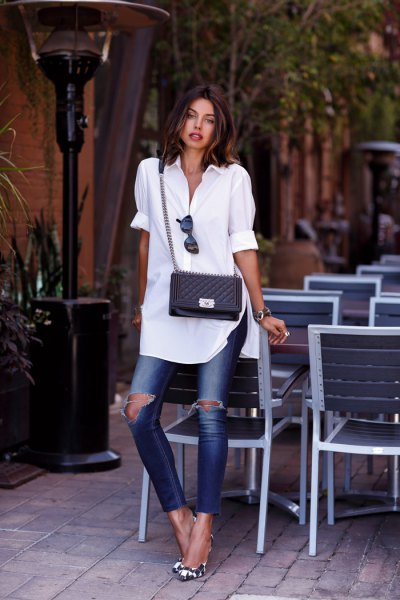 white tunic shirt with cuffs and ripped ankle jeans