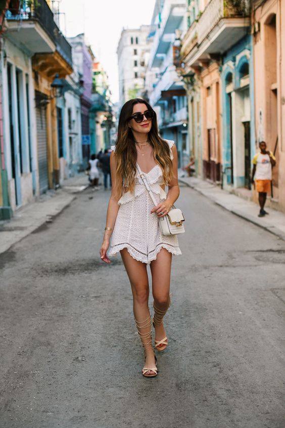 white cut out dress by the sea