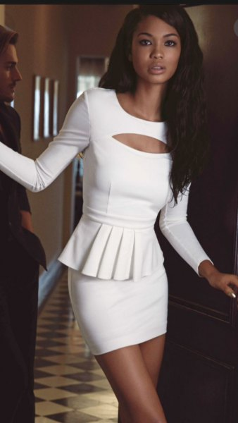 White peplum top with cut out front with figure-hugging mini skirt
