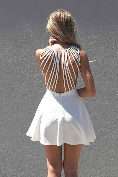 white mini skater dress with cut out back and matching high heels