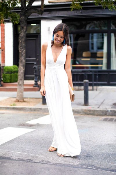white, deep V-neck maxi dress with a gathered waist and silver heels