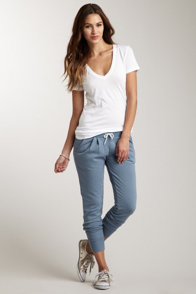 white t-shirt with deep V-neck and gray sweatpants
