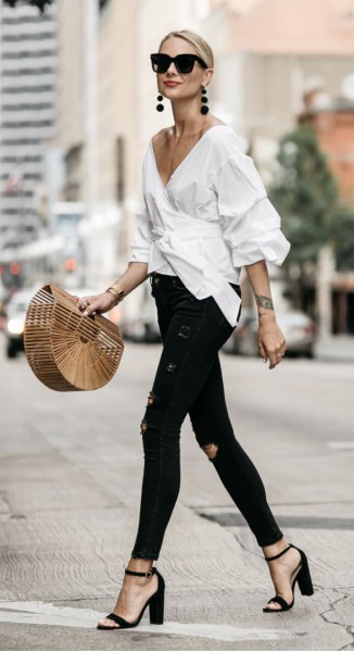white wrap shirt with deep V-neck and black skinny jeans