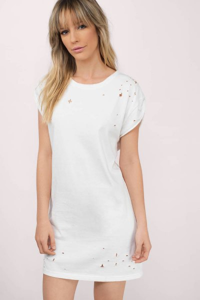 white distressed t-shirt dress with sneakers