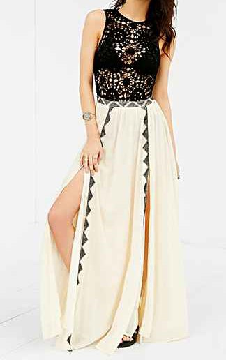 white, double-slit maxi skirt with sleeveless top made of black and silver sequins