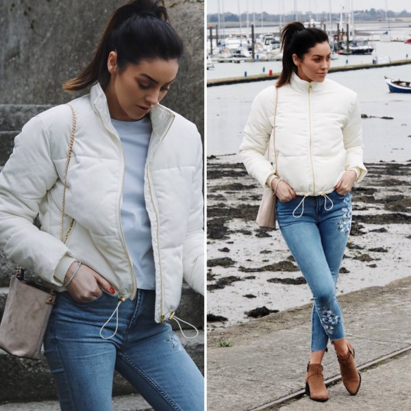 white down jacket with blue cut skinny jeans