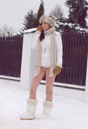 white down jacket with light gray knitted scarf and faux fur snowshoes