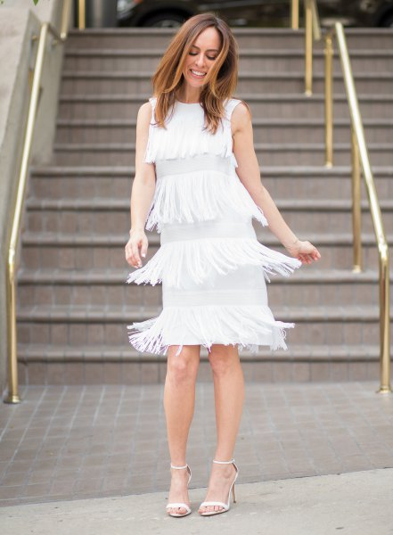white dress several layers of fringes