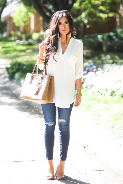 white, elegant tunic top with buttons and blue ribbed skinny jeans