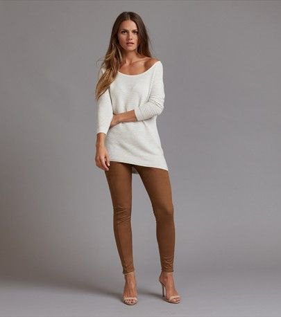 white drop shoulder knitted sweater green suede leggings