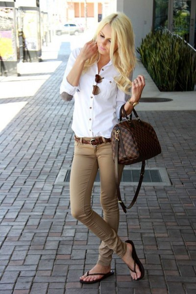 white elbow patch button up shirt with green khaki jeans