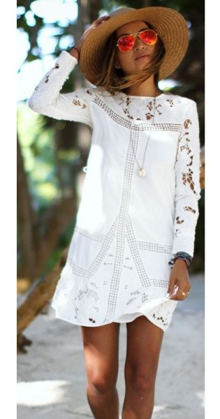 white embroidered long-sleeved mini dress with straw hat