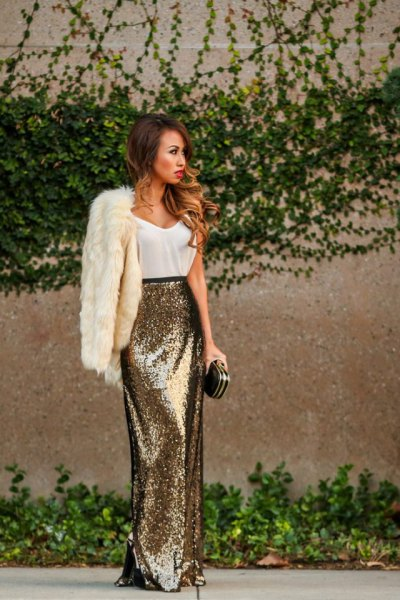 white faux fur coat with tank top and maxi gold sequin skirt