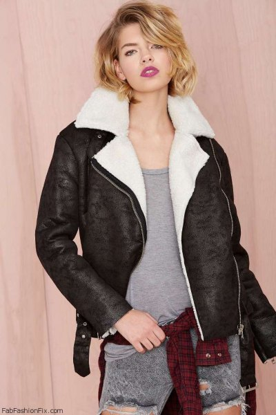 white faux fur collar black flight jacket with gray jeans