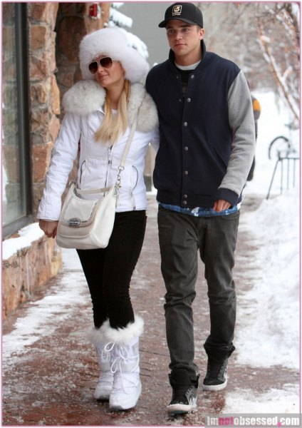 white faux fur collar coat with matching snowshoes