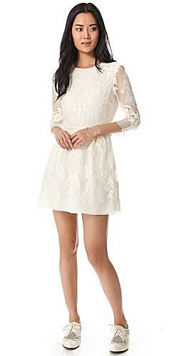 white mini dress with pointed and flared tip and wing tip shoes