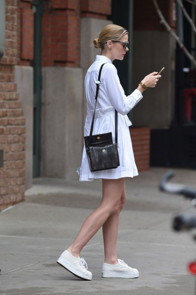 white cut and flared long-sleeved shirt dress with black handbag over the shoulder