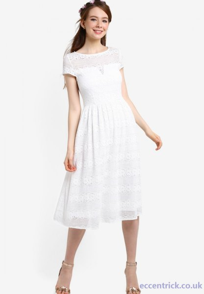 Short-sleeved party dress in white fit and flare with silver, open toe heels