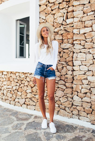 white fitted sweater with blue high-waisted denim shorts