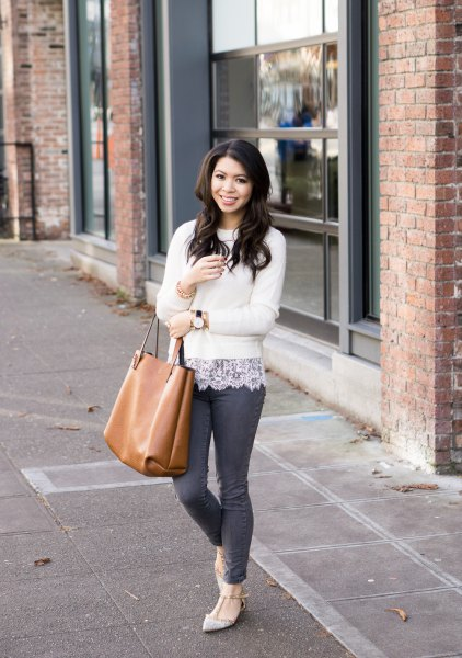 white, fitted sweater with lace blouse and light pink, pointed straps