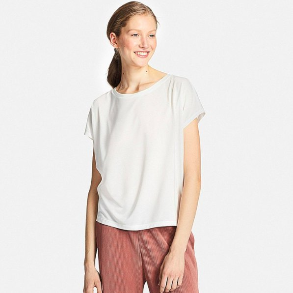 white t-shirt with green corduroy trousers with a relaxed fit