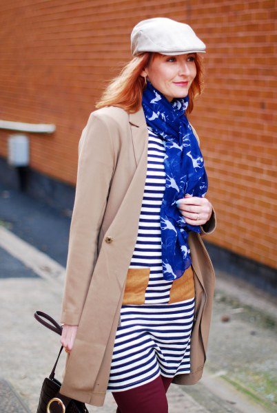 white flat cap with dark blue and white striped t-shirt dress