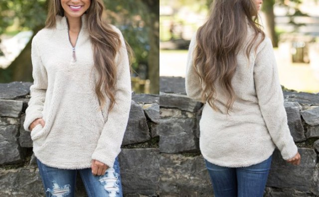 white fleece sweater with quarter zip, blue skinny jeans with zip