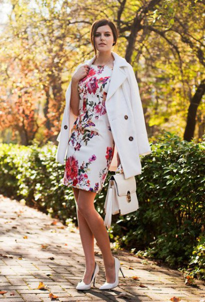 white, figure-hugging wool coat with a floral pattern