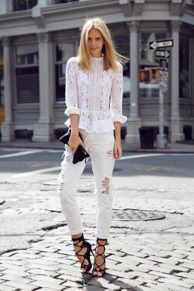 white blouse embroidered with flowers with ripped jeans and strappy heels
