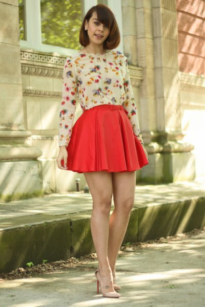 white floral long-sleeved blouse, red pleated minirater skirt