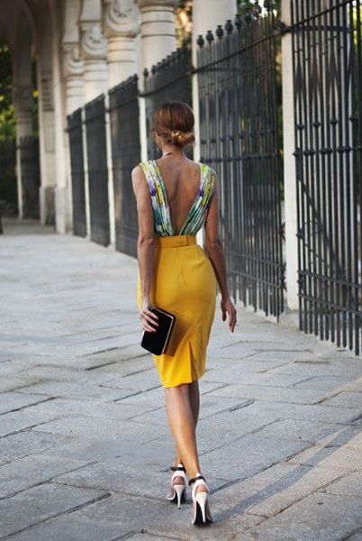 backless top with white floral print and mustard yellow pencil skirt