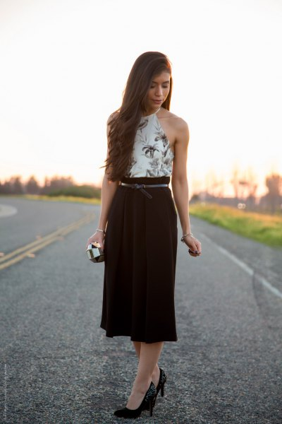 white halterneck top with floral pattern and black midi high-rise skirt