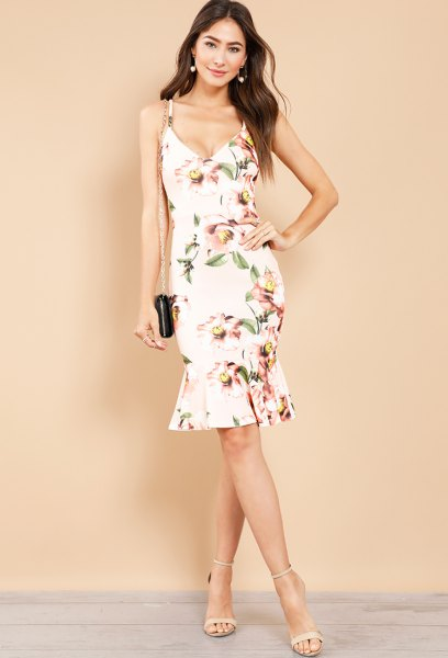 white midi dress with floral pattern and light pink heels with open toes