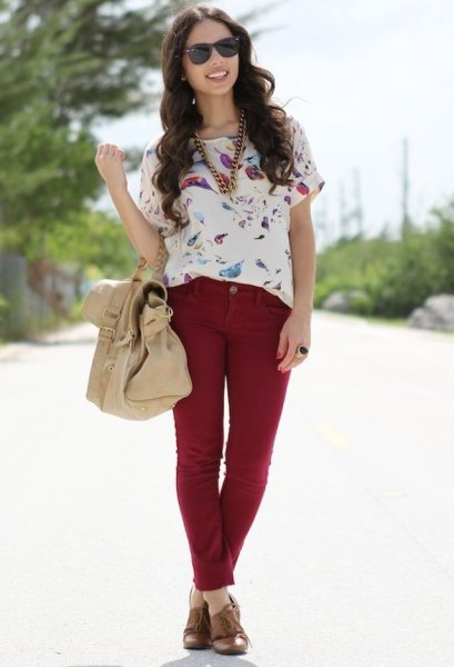 white short-sleeved blouse with floral pattern and red slim fit jeans