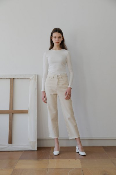 white, figure-hugging long-sleeved T-shirt with ivory-colored jeans