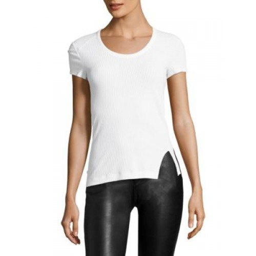 white figure-hugging t-shirt with black leather gaiters