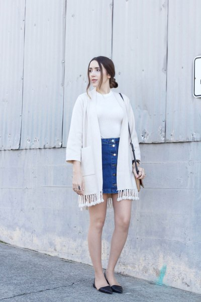 white cardigan with fringes and blue mini skirt