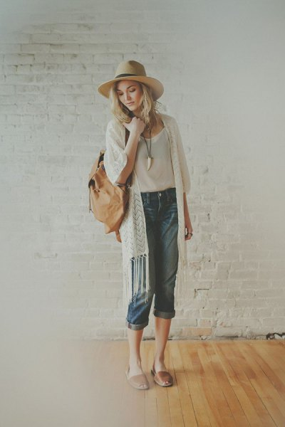 white fringed longline cardigan with white straw hat and blushing pink slide sandals
