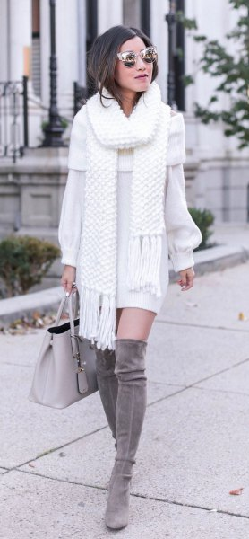 white fringed scarf with matching sweater dress and gray overknee boots