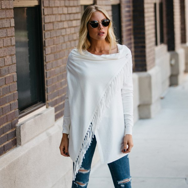 ripped jeans with white fringes