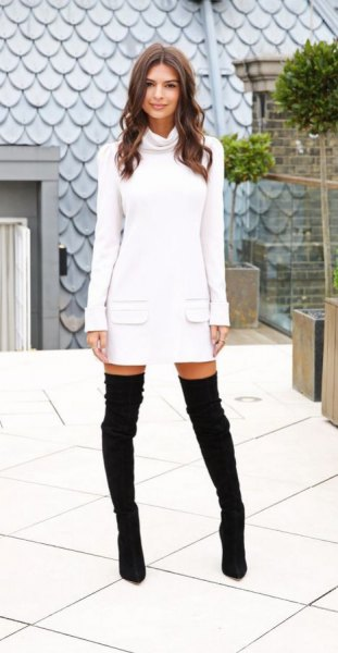 white sweater dress with front pocket and black overknee boots