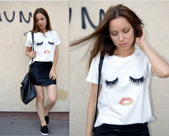 white funny graphic tee with black mini leather skirt