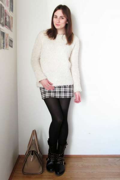 white fuzzy sweater with a mini plaid skirt made of wool and stockings