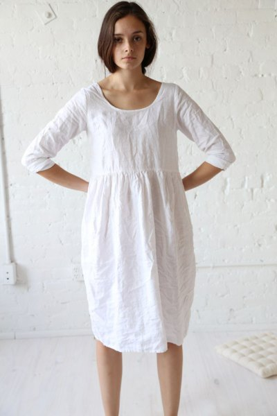 white tunic dress from a ruched linen waist with sneakers