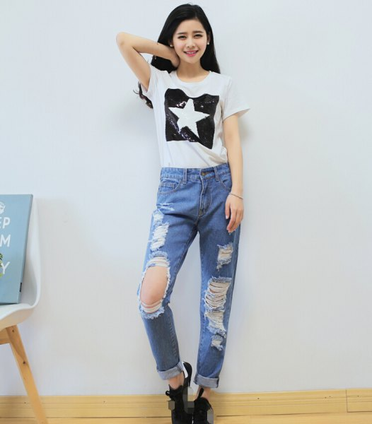 white graphic t-shirt with light blue ripped boyfriend jeans