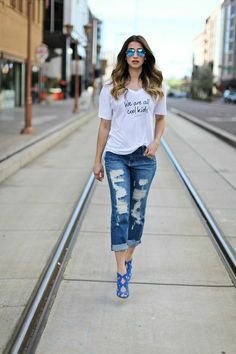white graphic t-shirt with torn and tied boyfriend jeans