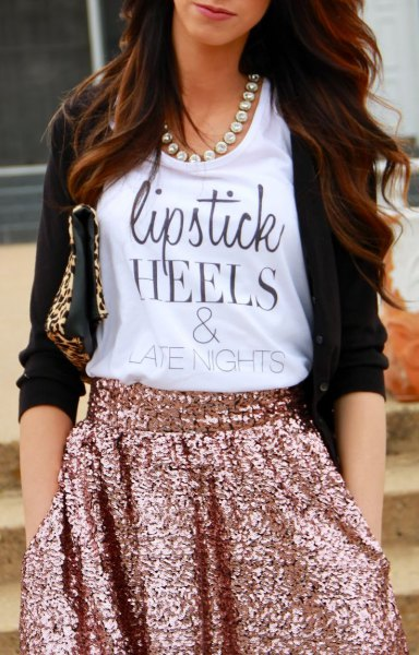 white graphic tank top with cardigan and rose gold-colored mini skirt